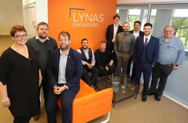Forefront of image, from left, drainage engineer Helen Langton, operations manager Lee Smith and managing director, Rob Lynas with the Lynas Engineering team