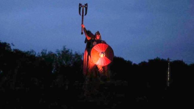 Carl Howe holding his axe as the Viking king at Kynren