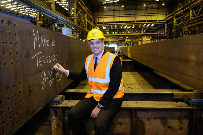 Tees Valley Mayor Ben Houchen signs the steel girder for the highway bridge being manufactured at Cleveland Bridge UK