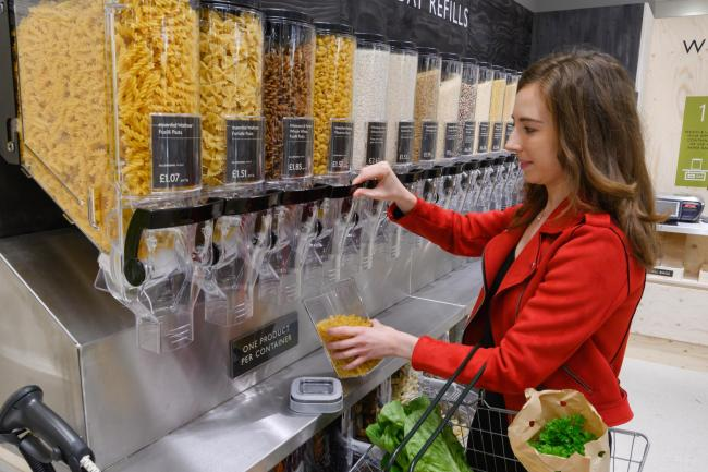 Waitrose is trialling the use of refill stations, pictured, to cut packaging waste at several stores